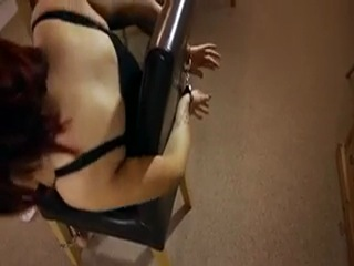 Cuffed girl on chair